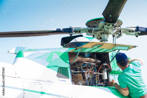 Poster Helicopter Engineer maintaining a helicopter Engine