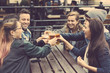 canvas print picture - Group of friends enjoying a beer at pub in London