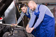 car mechanics working at carshop