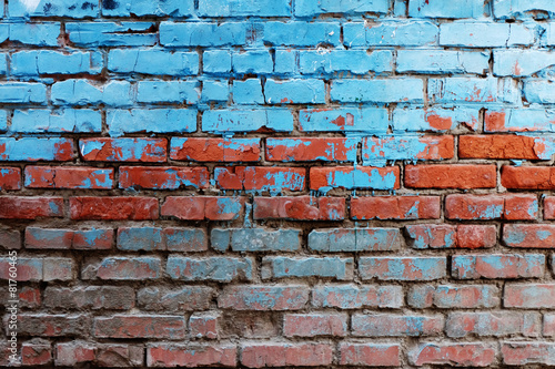 Foto op Plexiglas Wand Old red brick wall half painted in bright blue color a lot of