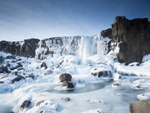 Waterfall In The Winter In Pingvellir Valley In Iceland