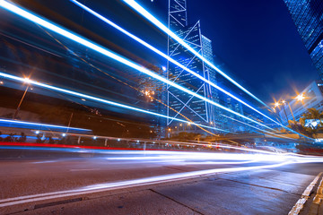 Fototapeta na wymiar traffic light trails in modern city street