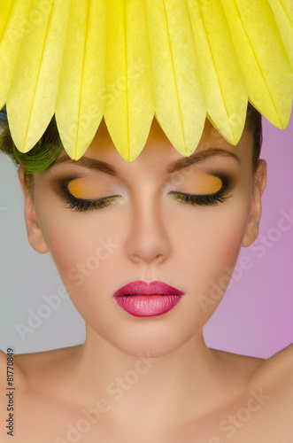 Beautiful woman with yellow paper
