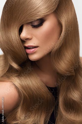Obraz na plátně  Hair. Portrait of beautiful Blonde with Long Wavy Hair. High qua
