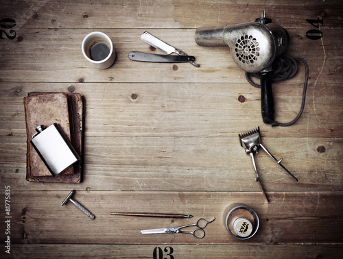 Fotografering  Vintage barber shop equipment on wood background with place for