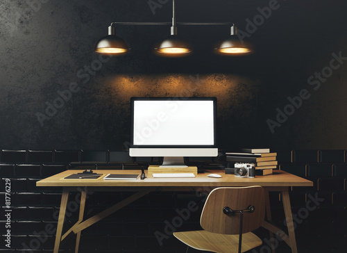 Fotografía  Mock up of generic design computer screen. Workspace in the blac