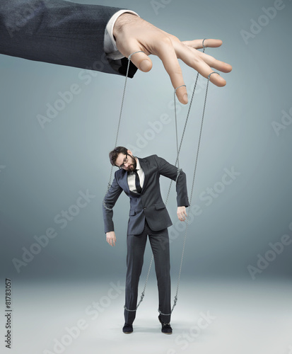 Photo  conceptual picture of a boss pulling the strings