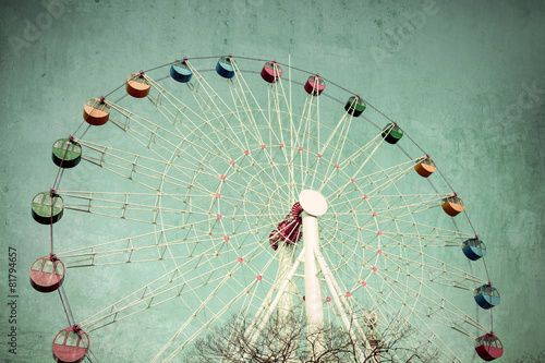 Foto auf Leinwand Retro Colorful Giant ferris wheel against, Vintage style