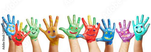 Leinwand Poster Panorama aus vielen bunten Kinderhänden