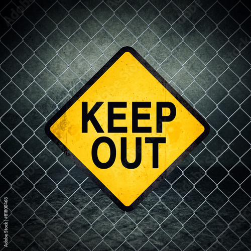 Keep Out Grunge Yellow Warning Sign on Chainlink Fence Poster