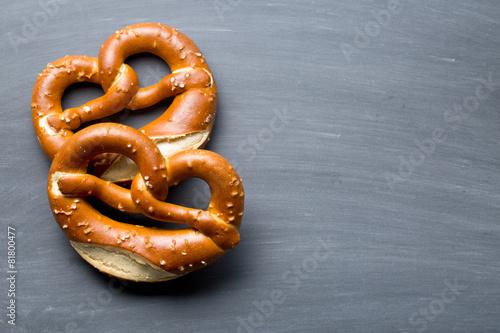 Fotografie, Obraz baked pretzel on a chalkboard