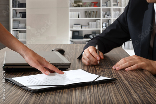Fotografie, Obraz  female hand pointing to businessman at signature place on a cont