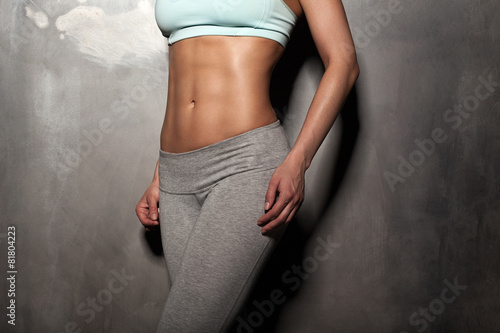 Fotografie, Obraz  Fitness female woman with muscular body, do her workout, abs, ab