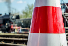 Cone With Blurry Steam Train In Background