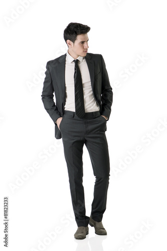 Fotografie, Obraz  Full figure shot of handsome elegant young man in business suit