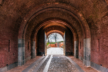 Fototapeta Red brick arch in Daugavpils fortress