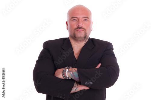 Mann mit Glatz und verschränkten Armen im Anzug Canvas Print