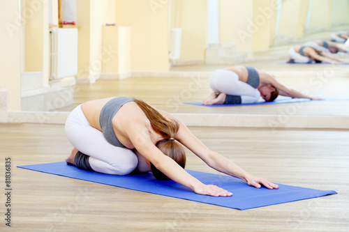 Valokuva  girl doing yoga exercises in the gym