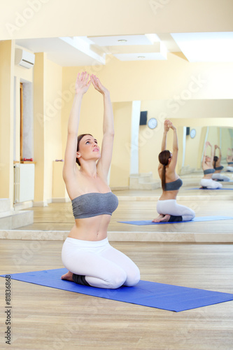 beautiful girl doing exercises in the gym Canvas-taulu