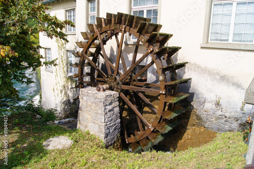 watermill wheel between the house and the kitchen cupboard