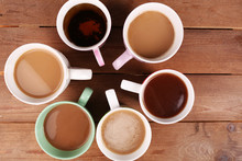 Cups Of Cappuccino On Wooden Table, Top View