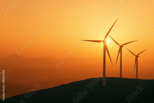 Aluminium Prints Mills wind turbines silhouette on mountain at sunset