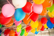 Colorful Balloons Floating On The Ceiling Of A Party