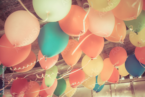 Fényképezés Colorful balloons floating on the ceiling of a party in vintage