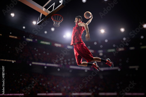 Fotografering  red Basketball player in action