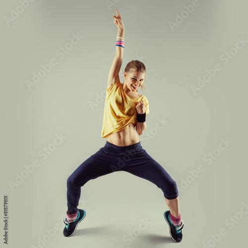 Vászonkép  Young happy woman artist performing jazz modern dance.