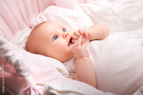 Photo Infant in a bassinet