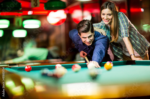 Fotografie, Obraz  Young couple playing pool