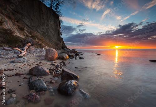 Cliff on sea shore at sunrise. Baltic sea long exposure photo