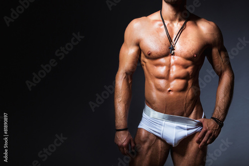 Obraz Muscular and sexy torso of young man in panties - fototapety do salonu