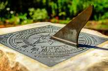 A Brass Sundial Mounted On A S...