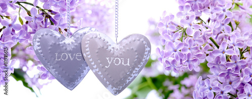 Lilac flowers and metal hearts