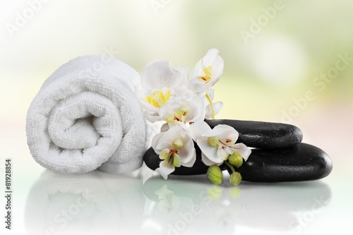 Canvas Prints Countryside Spa Treatment. Towel, gladiola and pebbles for massage