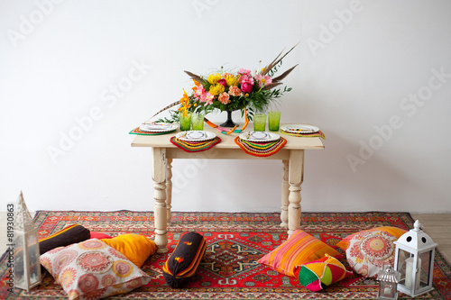 Fotografering  bright boho flowers on the served table