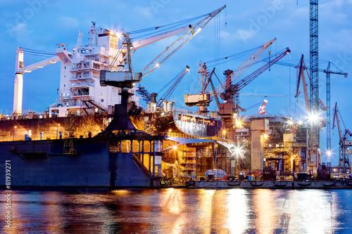 Obraz na plátne Shipyard at work, ship repair, freight. Industrial