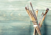 Paint. Photo Of Paint Brushes In A Jar