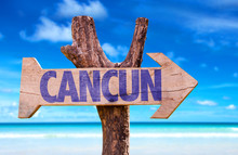 Cancun Wooden Sign With Beach Background