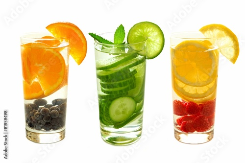 Detox water with fruit in glasses isolated on white