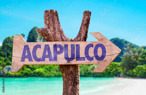 Obraz na plátne Acapulco wooden sign with beach background