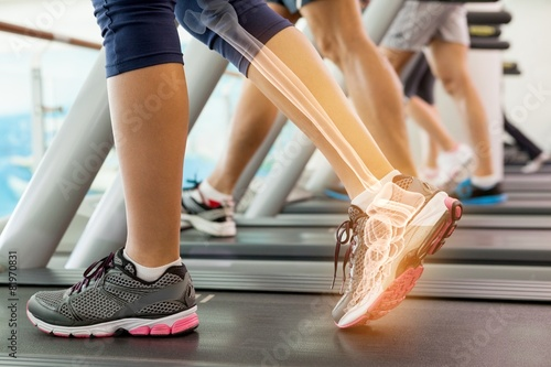 Foto op Plexiglas Fitness Highlighted ankle of woman on treadmill