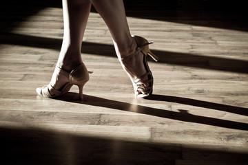 Female feet on the dance floor