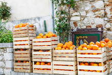 Oranges In Wooden Boxes On Str...