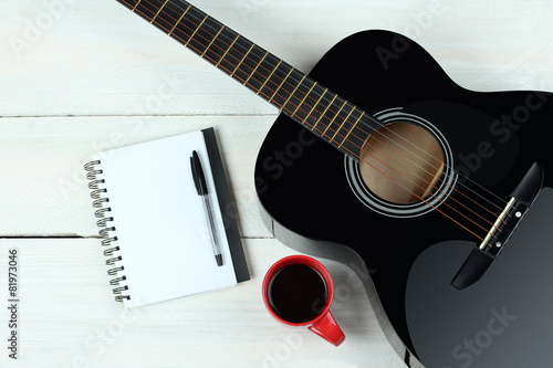 Acoustic guitars with a cup of coffee on wood background Fototapet