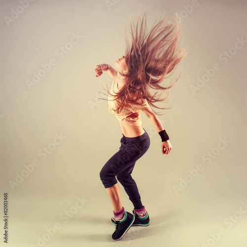 Plagát  Studio shoot of active female funk jazz dancer moving.