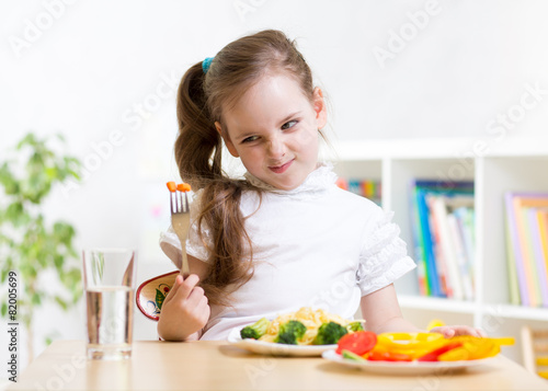 Valokuva  kid refusing to eat his dinner