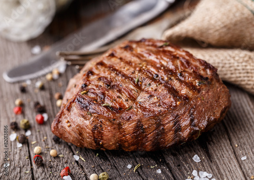Fotografering  Beef steak on a wooden board